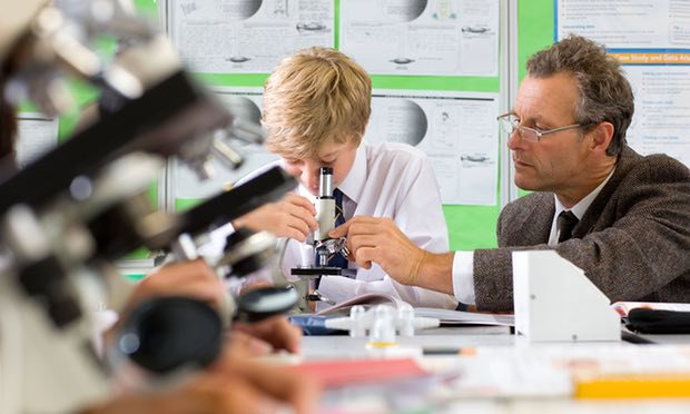Teacher and student with microscope